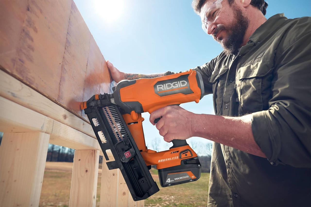 Handheld power drill, Pneumatic tool, Sky, Vehicle, Workwear, Plant