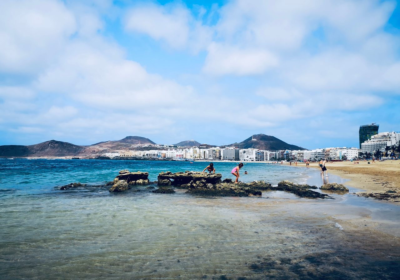 Coastal and oceanic landforms, Cloud, Water, Sky, Blue, Beach, Mountain, Travel