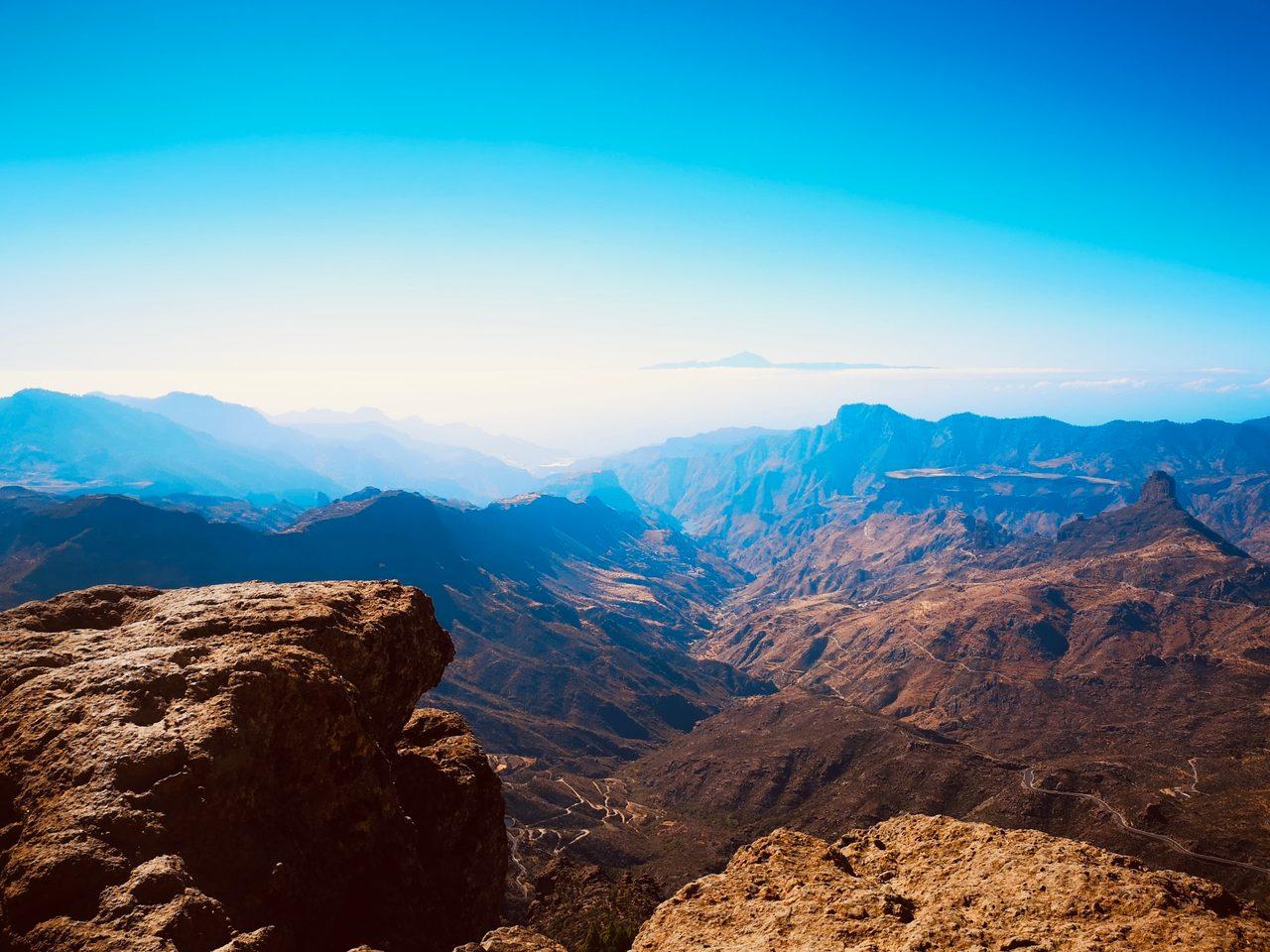 Natural landscape, Sky, Mountain, Azure, Cloud, Highland, Sunlight, Slope, Terrain