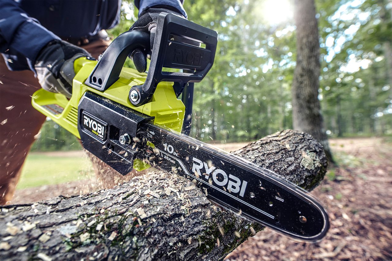 Sports equipment, Saw chain, Automotive tire, Motor vehicle, Chainsaw, Tree, Wheel, Plant, Asphalt, Wood