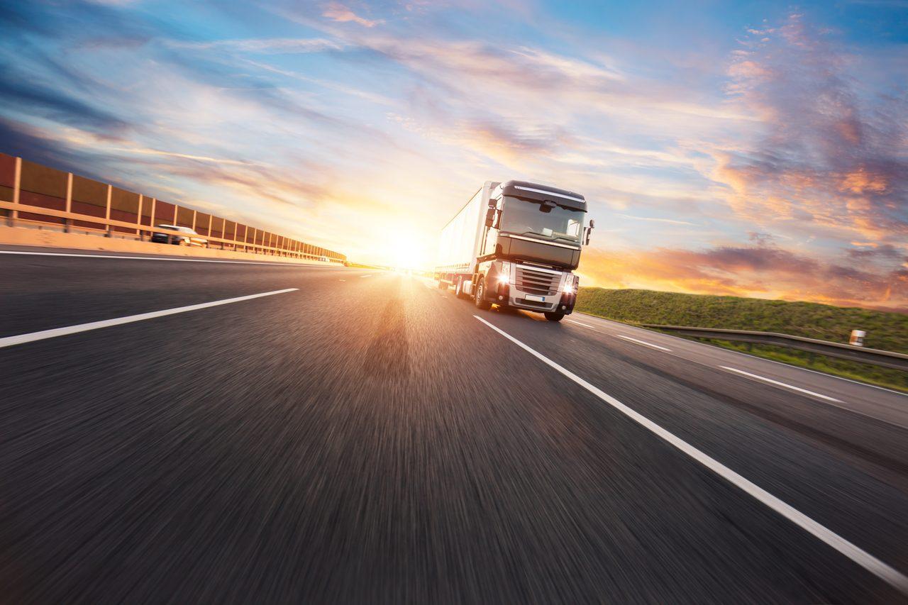 Land vehicle, Automotive lighting, Road surface, Cloud, Sky, Car, Asphalt