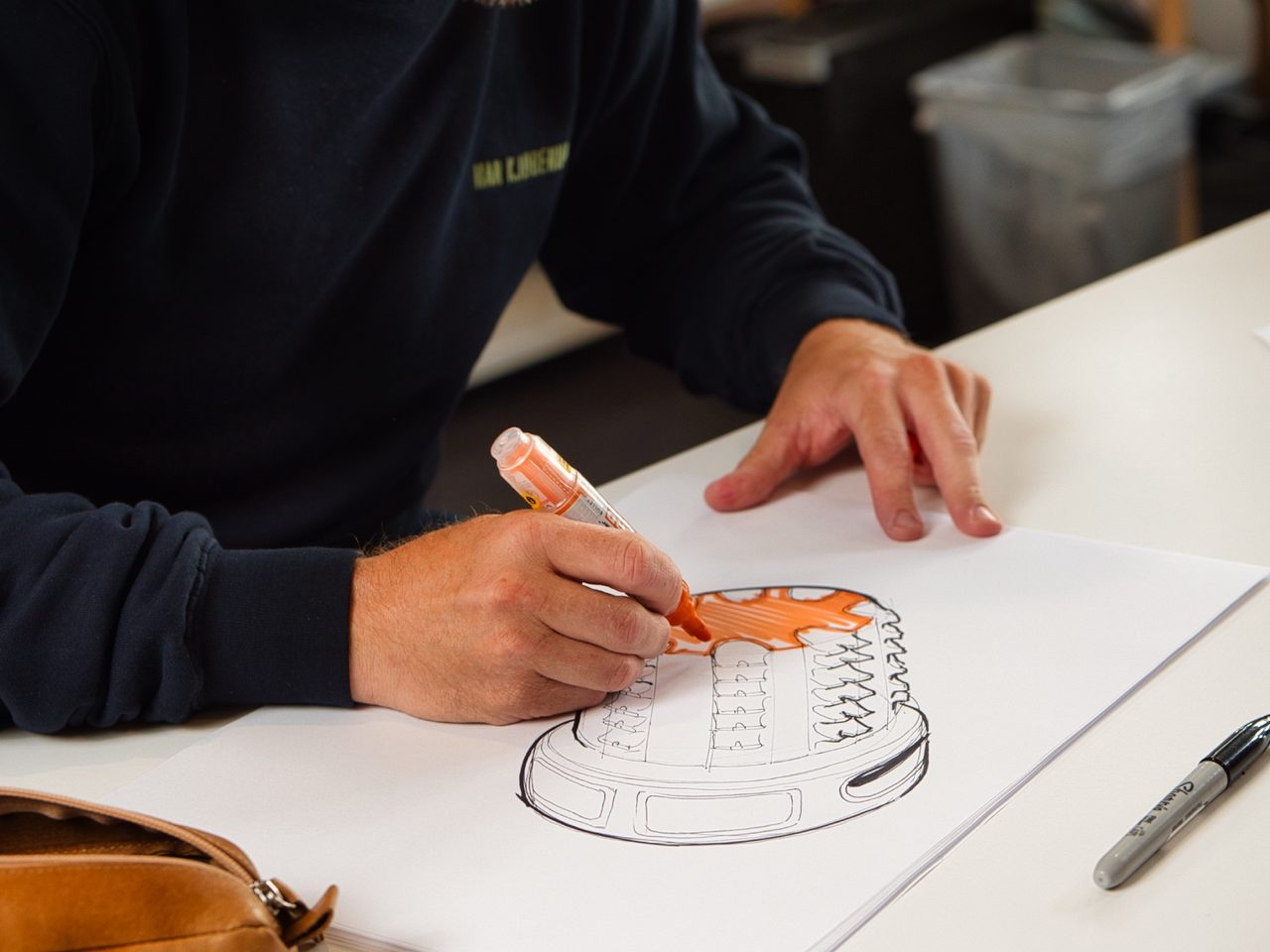 Writing instrument accessory, Automotive design, Office supplies, Table, Desk, Pen, Tableware, Finger, Art