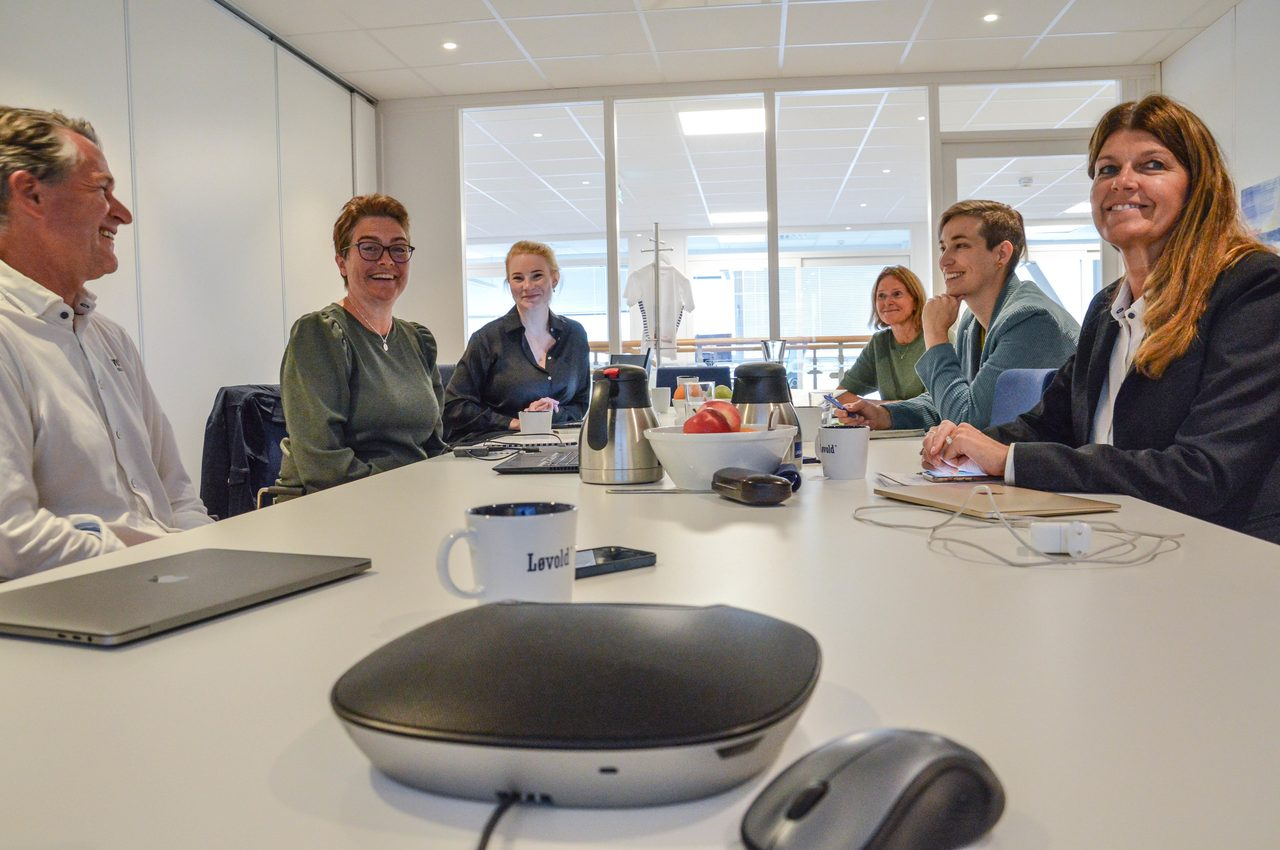 Conference room table, Interior design, Glasses, Furniture, Chair, Smile, Laptop