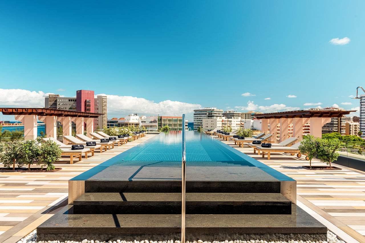 Swimming pool, Urban design, Sky, Water, Plant, Daytime, Property, Building, Azure, Cloud