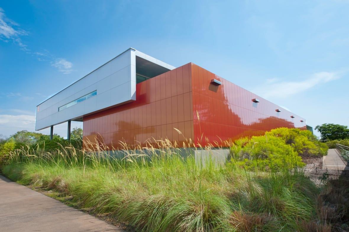 Land lot, Urban design, Sky, Plant, Cloud, Building, Architecture, Vegetation, Grass