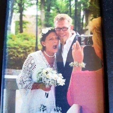 Wedding dress, Vision care, Bridal clothing, Smile, Glasses, Plant, Tree, Bride, Happy