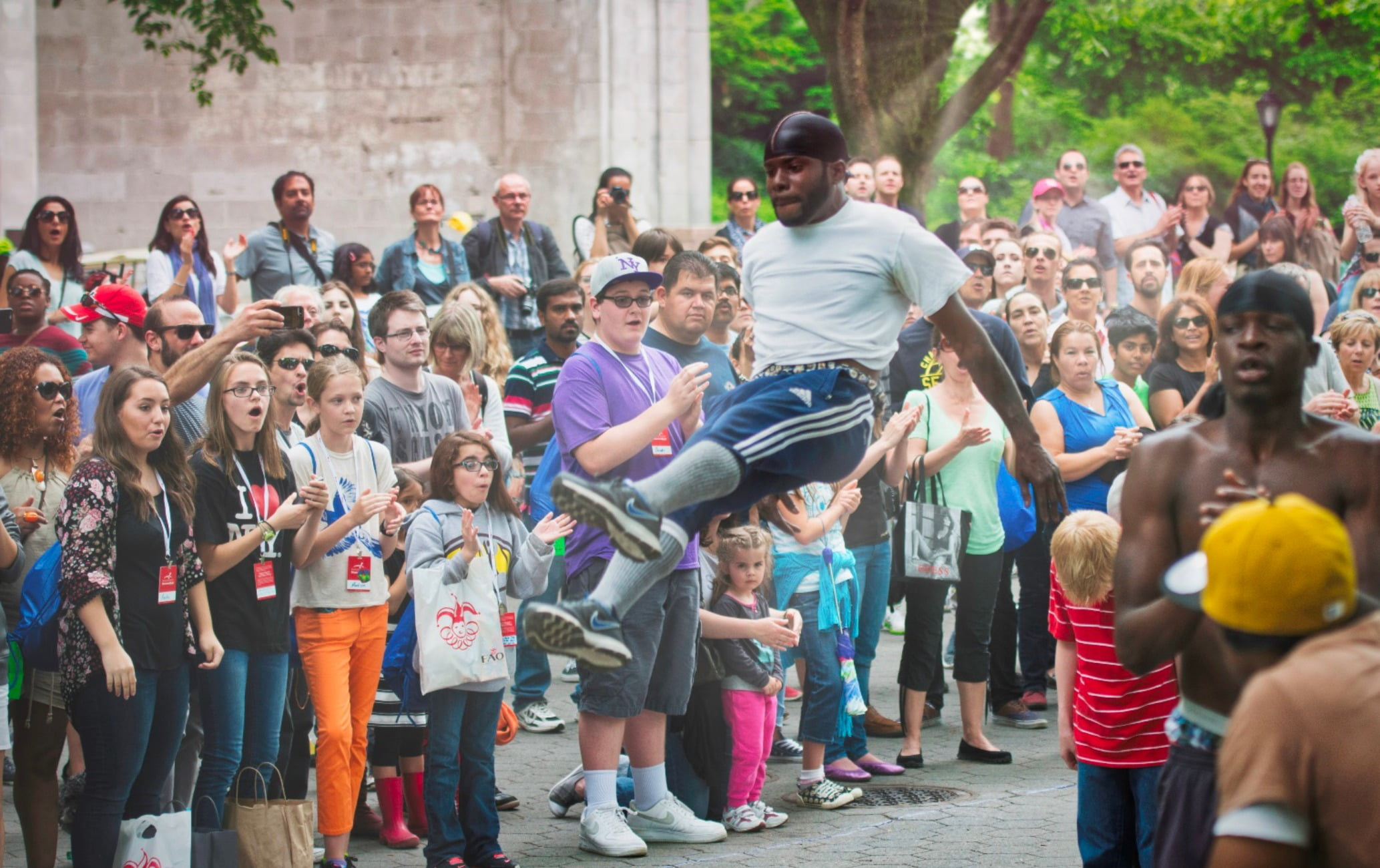 Public space, Audience, Child, Style, Community, Jeans, Crowd, People, Footwear