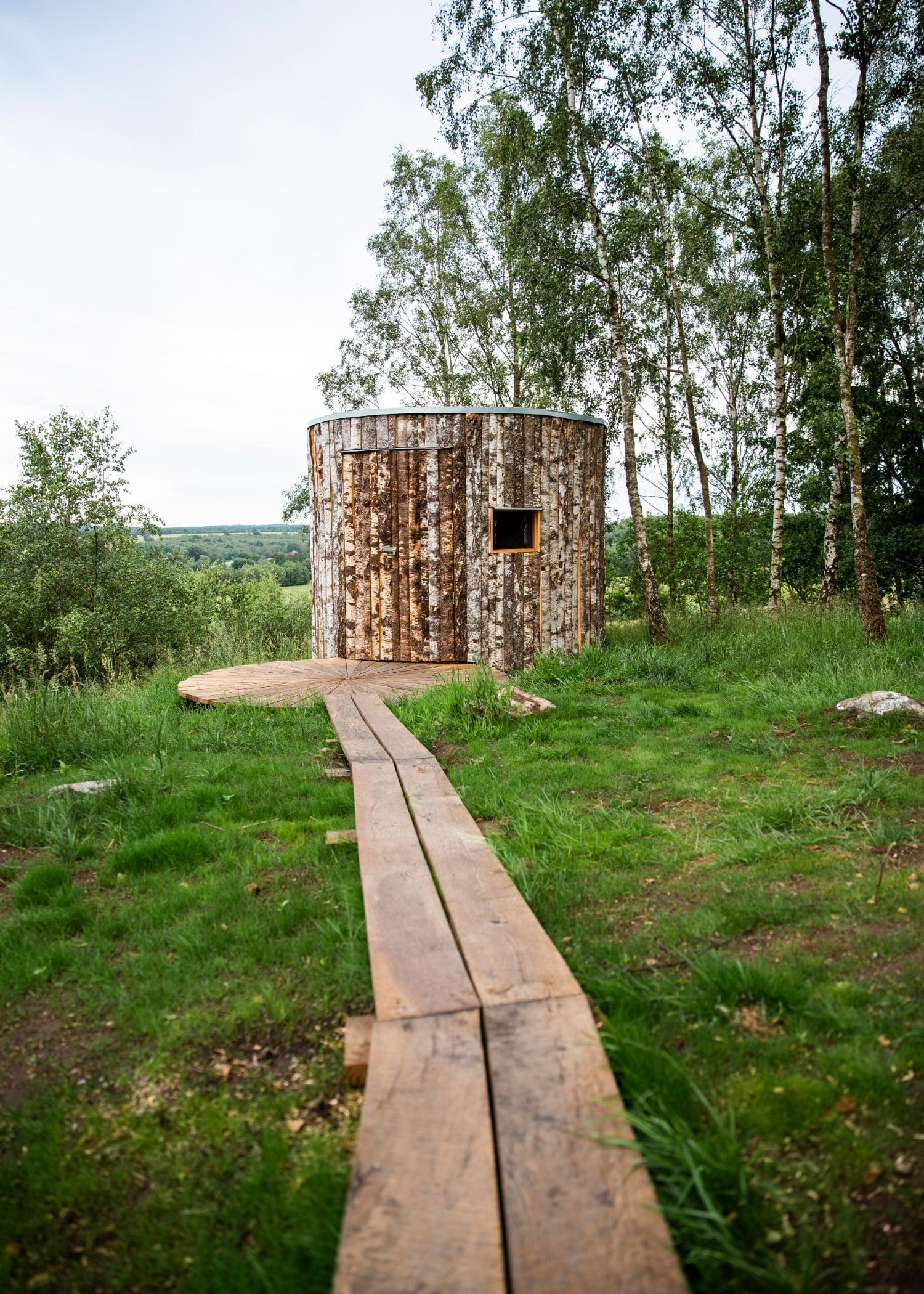 Natural landscape, Land lot, Plant, Sky, Wood, Building, Vegetation, Sunlight, Tree, Grass