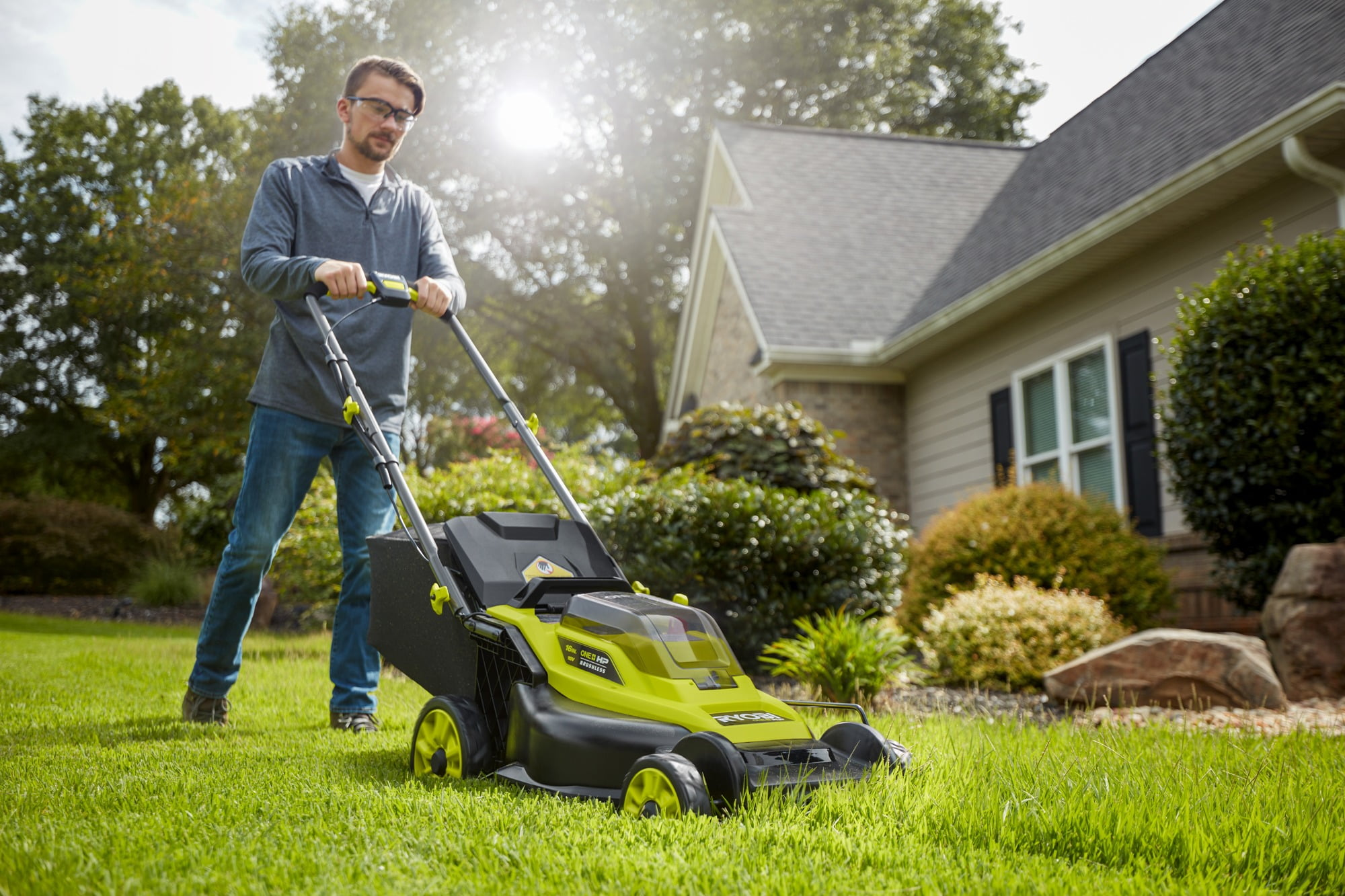 Lawn mower, Plant, Wheel, Tire, Sky, Grass, Tree, Yellow