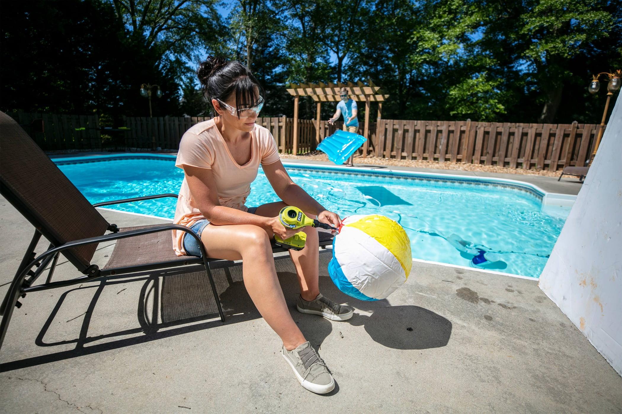 Swimming pool, Outdoor furniture, Water, Leg, Tree, Shorts, Thigh, Leisure, Sunlounger, Ball