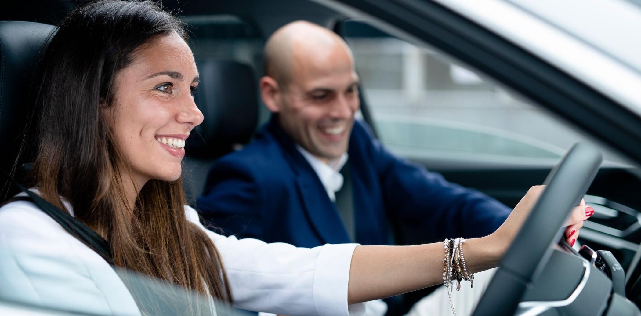Motor vehicle, Automotive design, Smile, Face, Hand, Car, Coat, Gesture, Suit