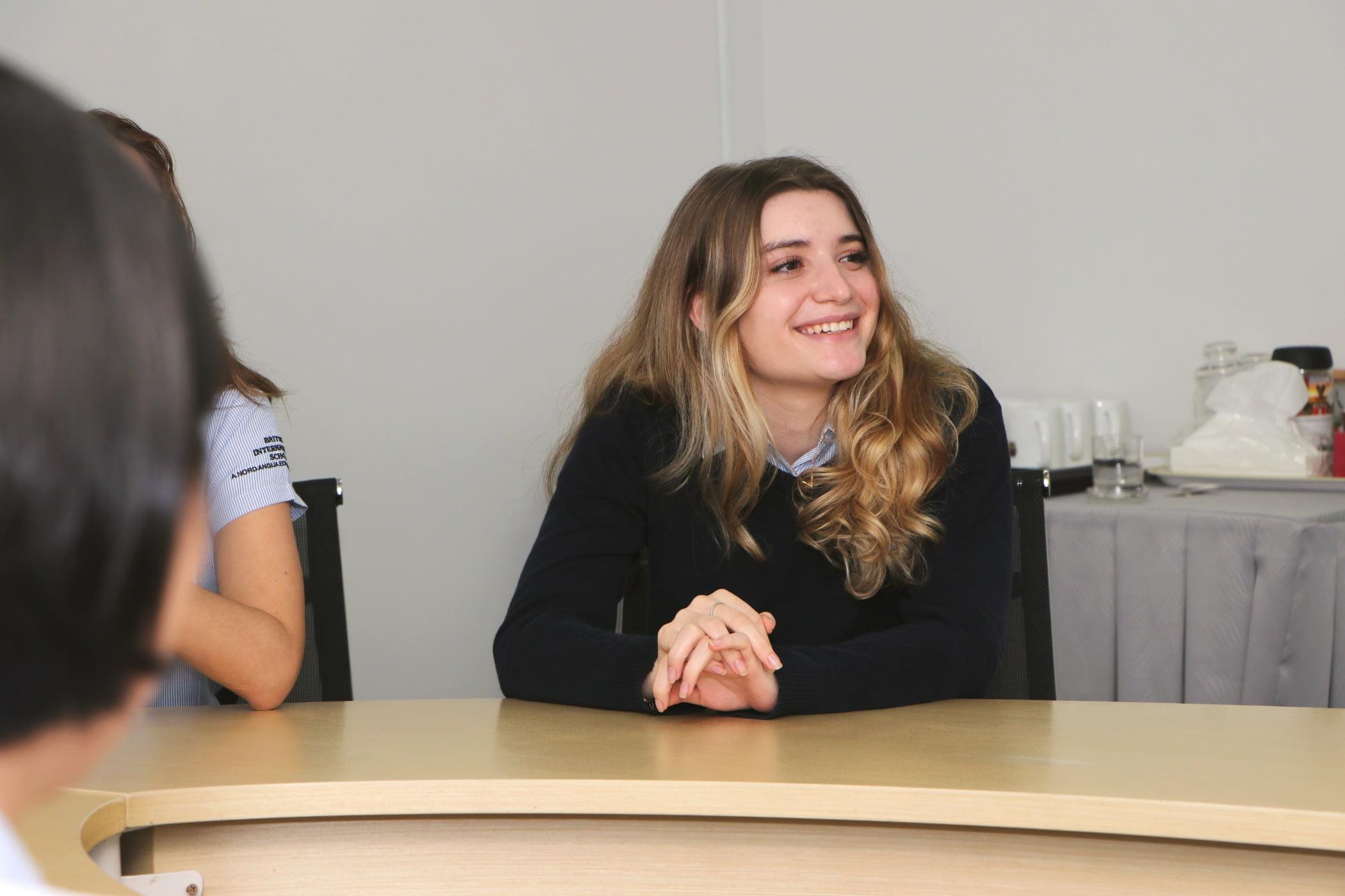 Smile, Table, Gesture, Desk
