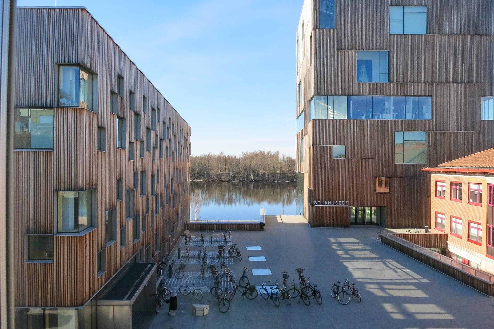 Urban design, Sky, Building, Window, Daytime, Water, Wood, Cloud, Lighting, Chair