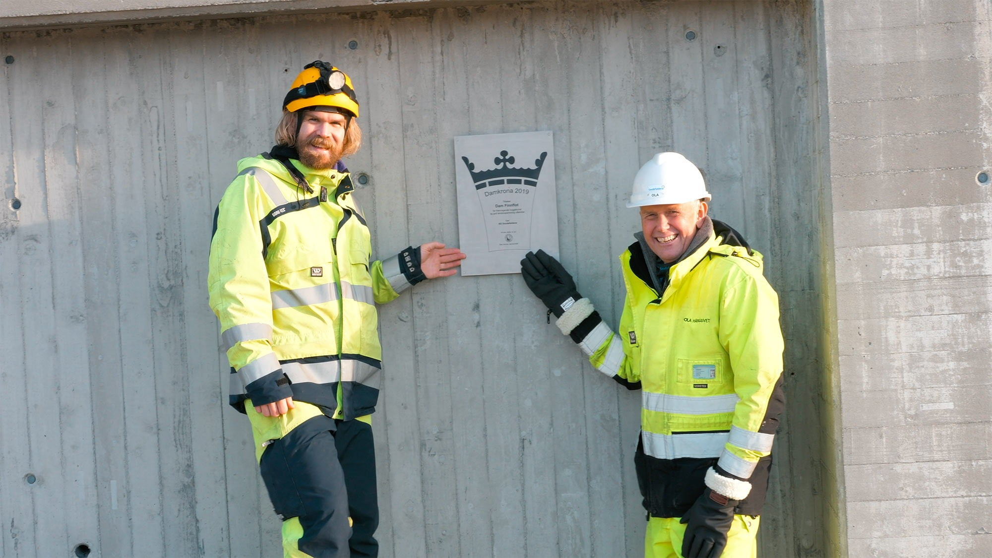 High-visibility clothing, Hard hat, Smile, Outerwear, Workwear, Helmet, Glove, Sleeve, Yellow, Jacket