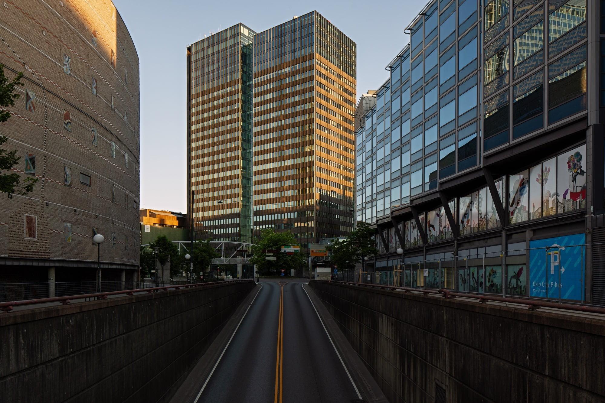 Tower block, Road surface, Urban design, Building, Daytime, Sky, Skyscraper, Tree, Window, Cityscape
