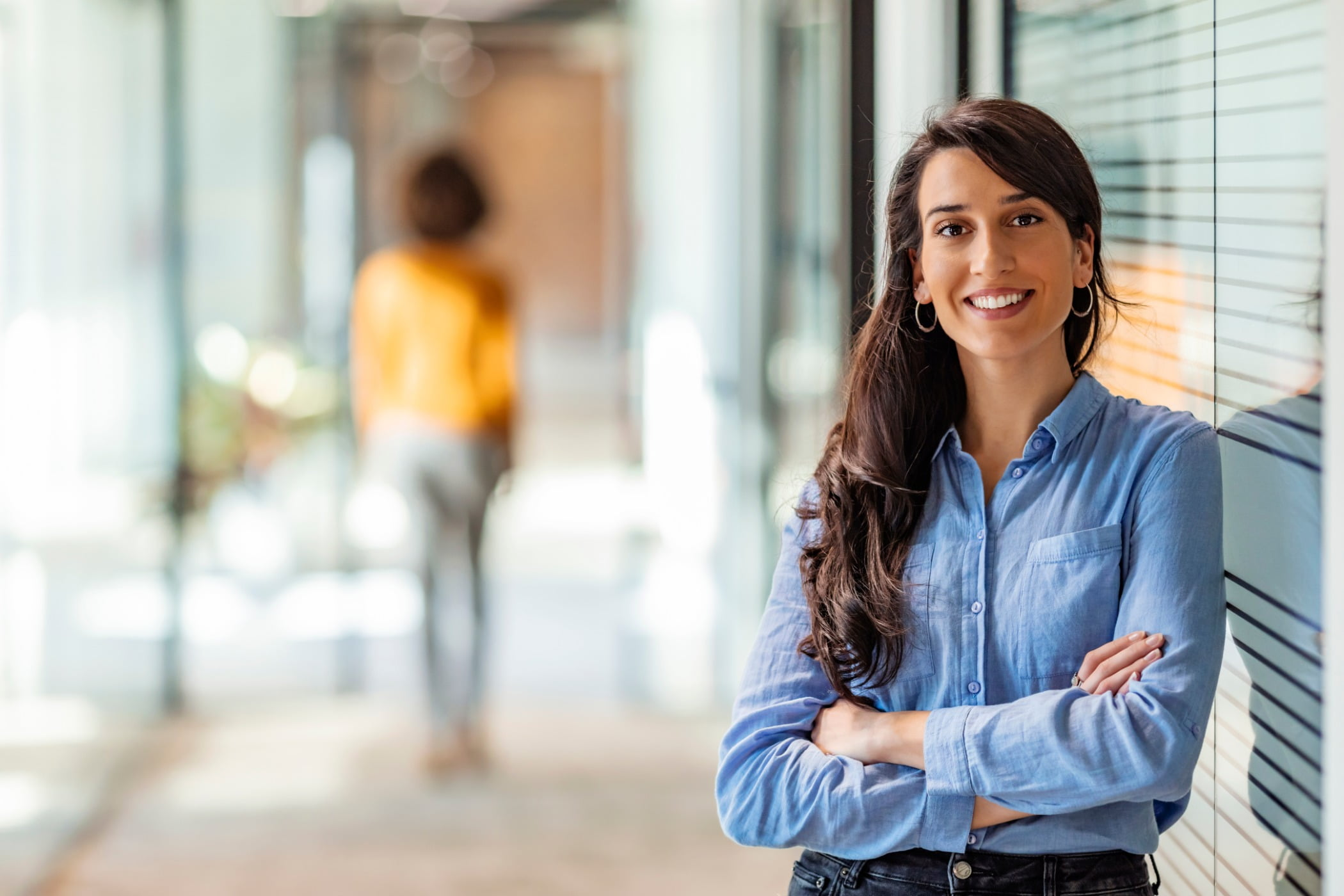 Confident businesswoman smiling to camera.