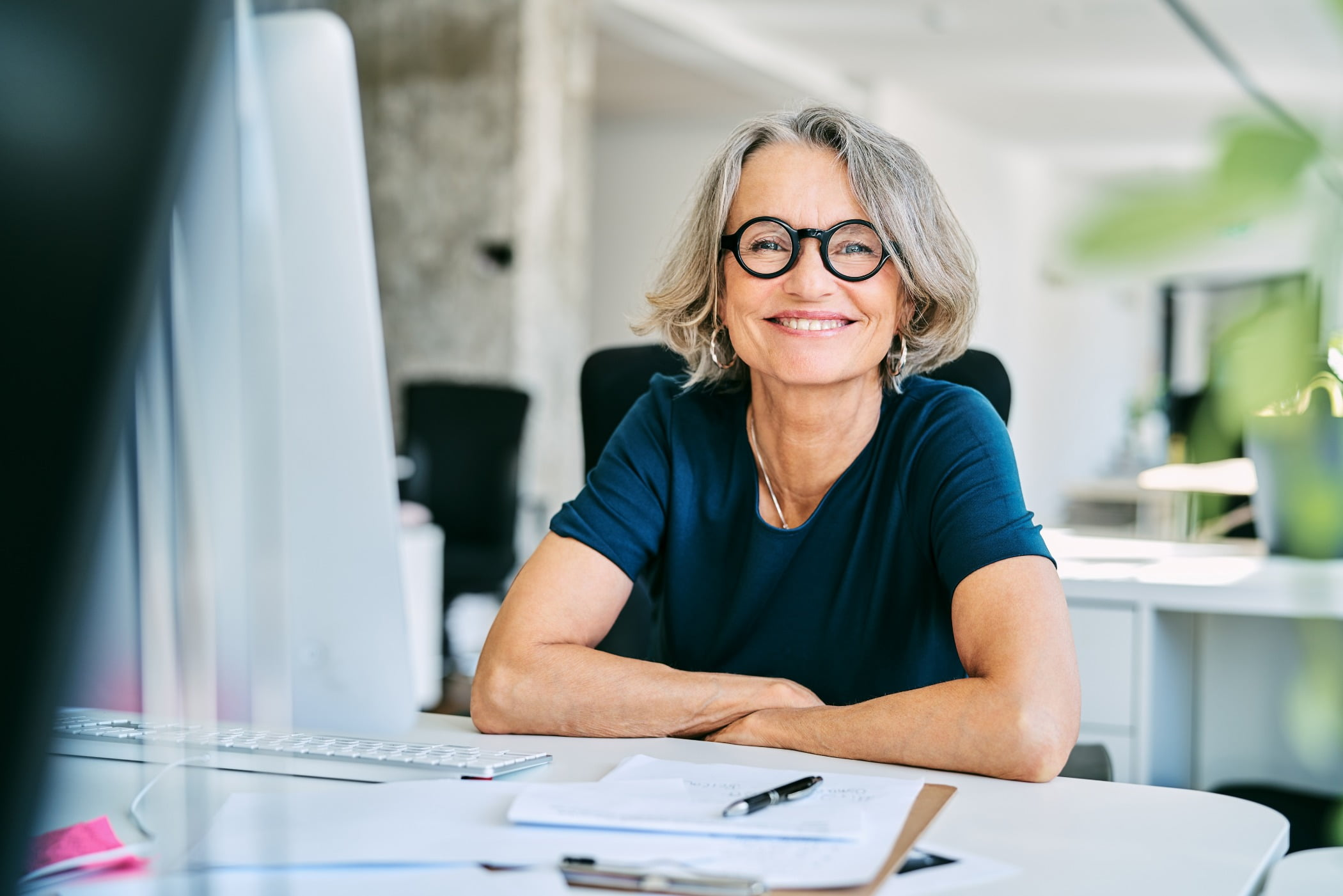 Smiling businesswoman at desk in office