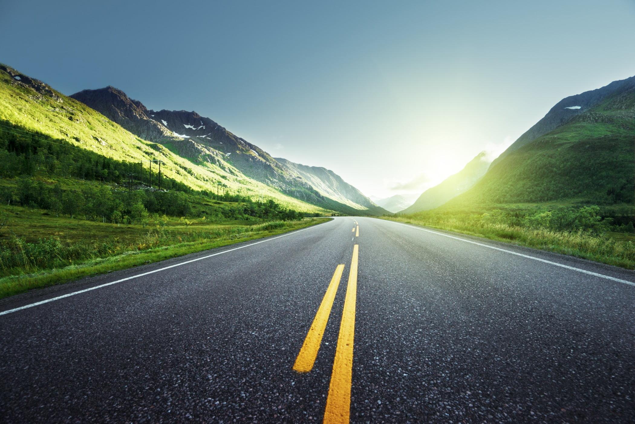 Road surface, Natural landscape, Mountainous landforms, Infrastructure, Asphalt, Yellow, Grass, Green, Nature