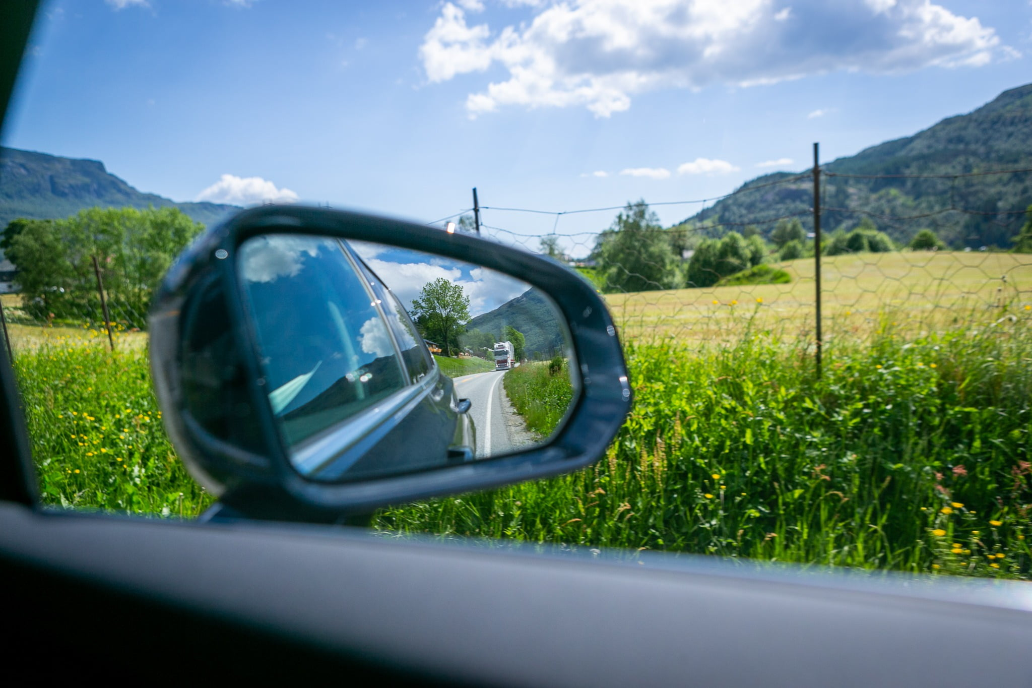 Automotive side-view mirror, Motor vehicle, Cloud, Sky, Plant, Car, Green