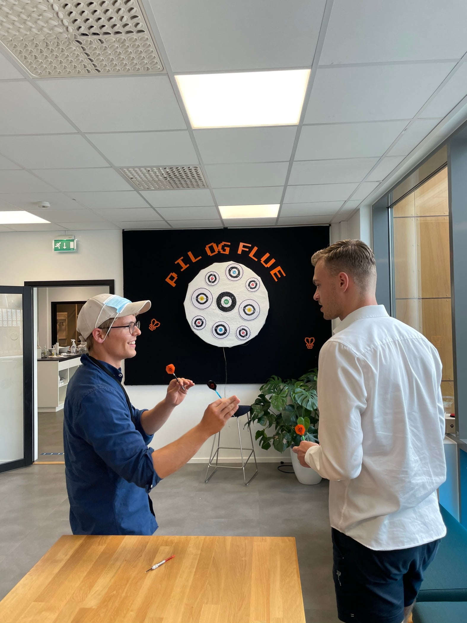 Interior design, Wheel, Table, Orange, Gesture