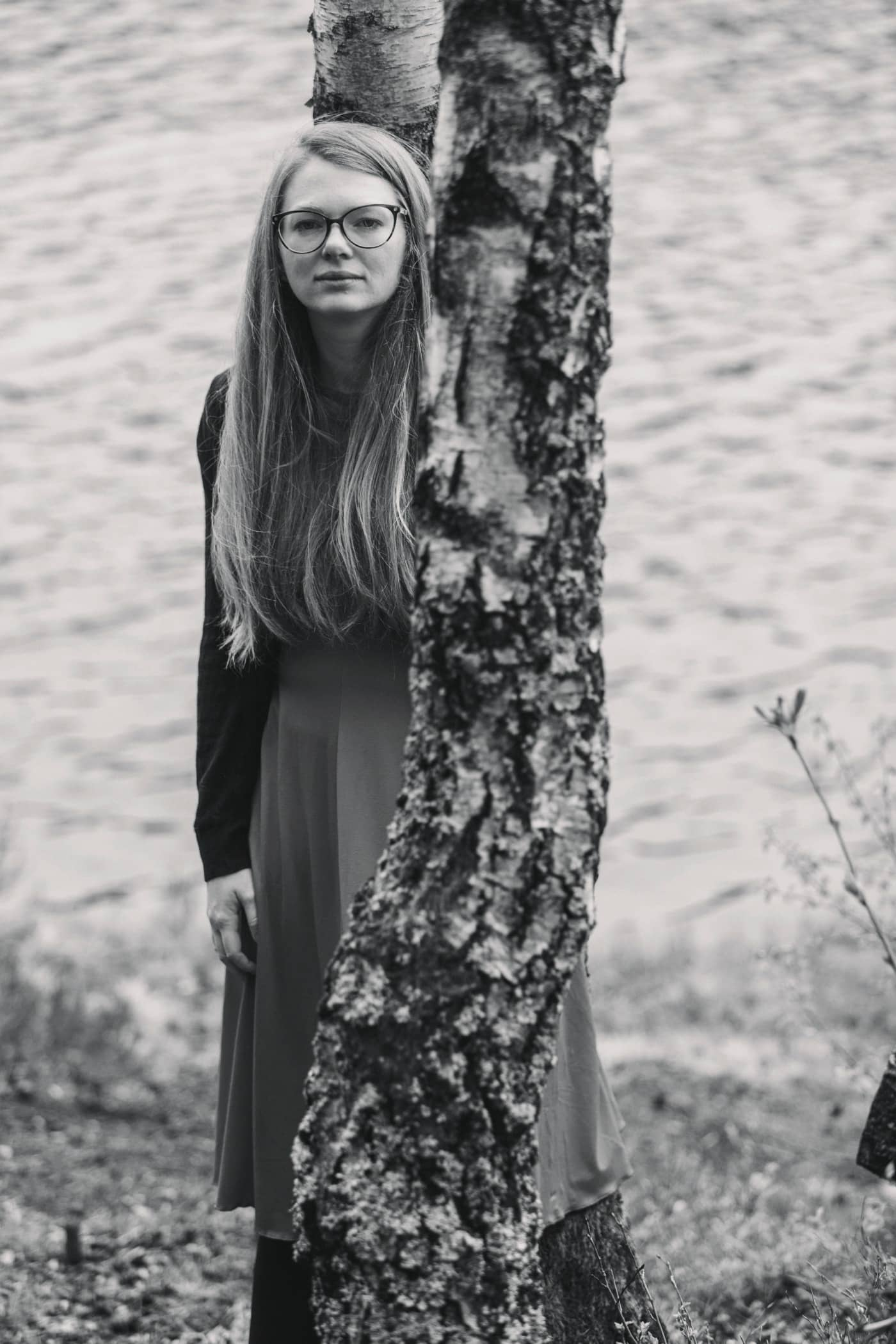 Long hair, Monochrome photography, Fashion, Eyewear, Beauty, Standing, Tree, Black-and-white, Photograph