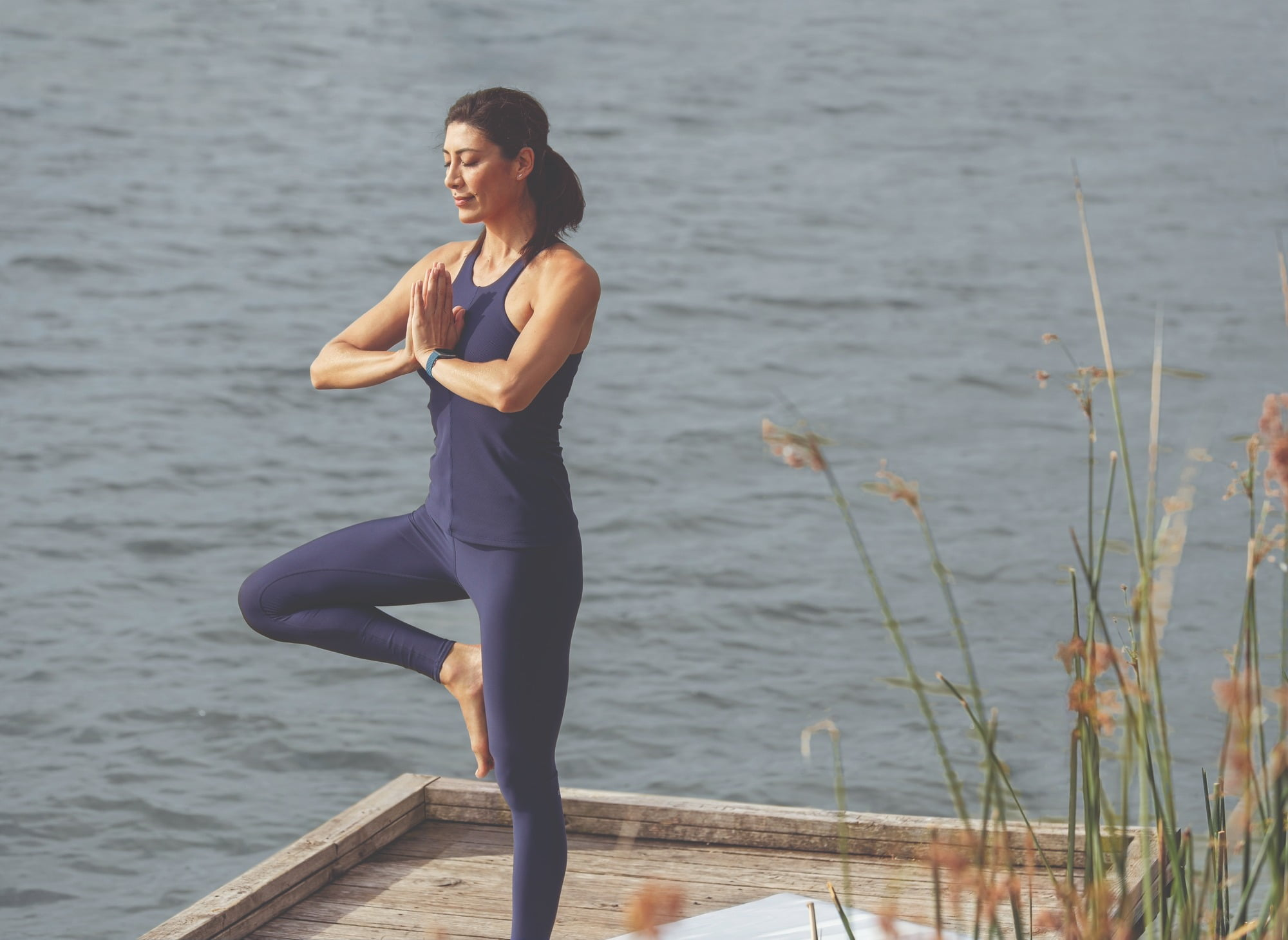 People in nature, Yoga mat, Active pants, Flash photography, Water, Hand, Shoulder, Plant, Neck