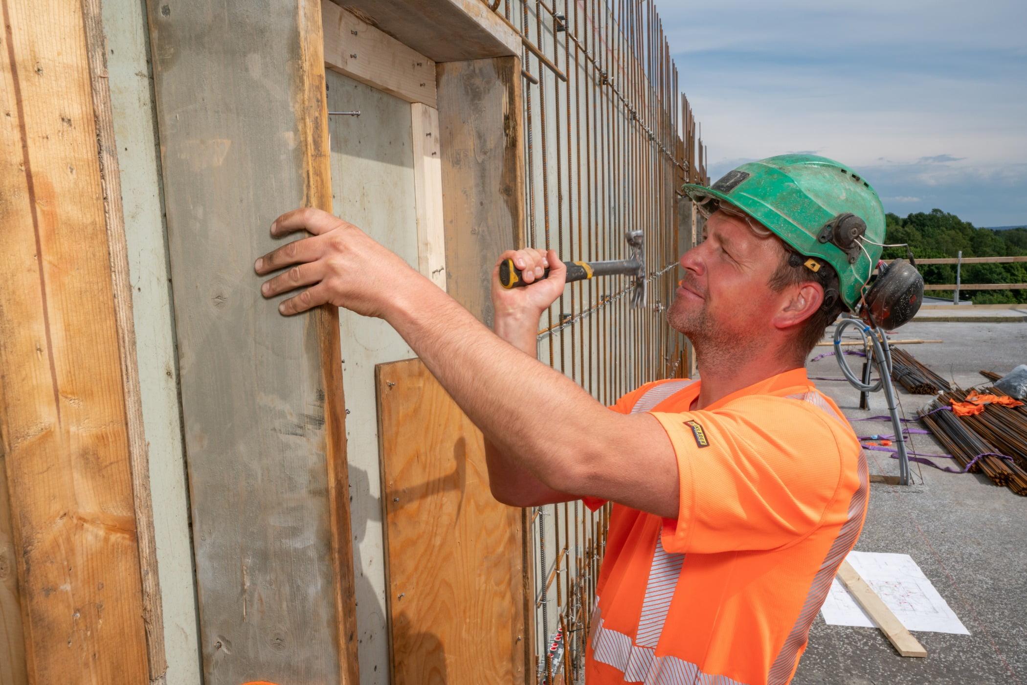 Hard hat, Blue-collar worker, Sky, Tradesman, Workwear, Wood, Building, Cloud, Wall, Vest