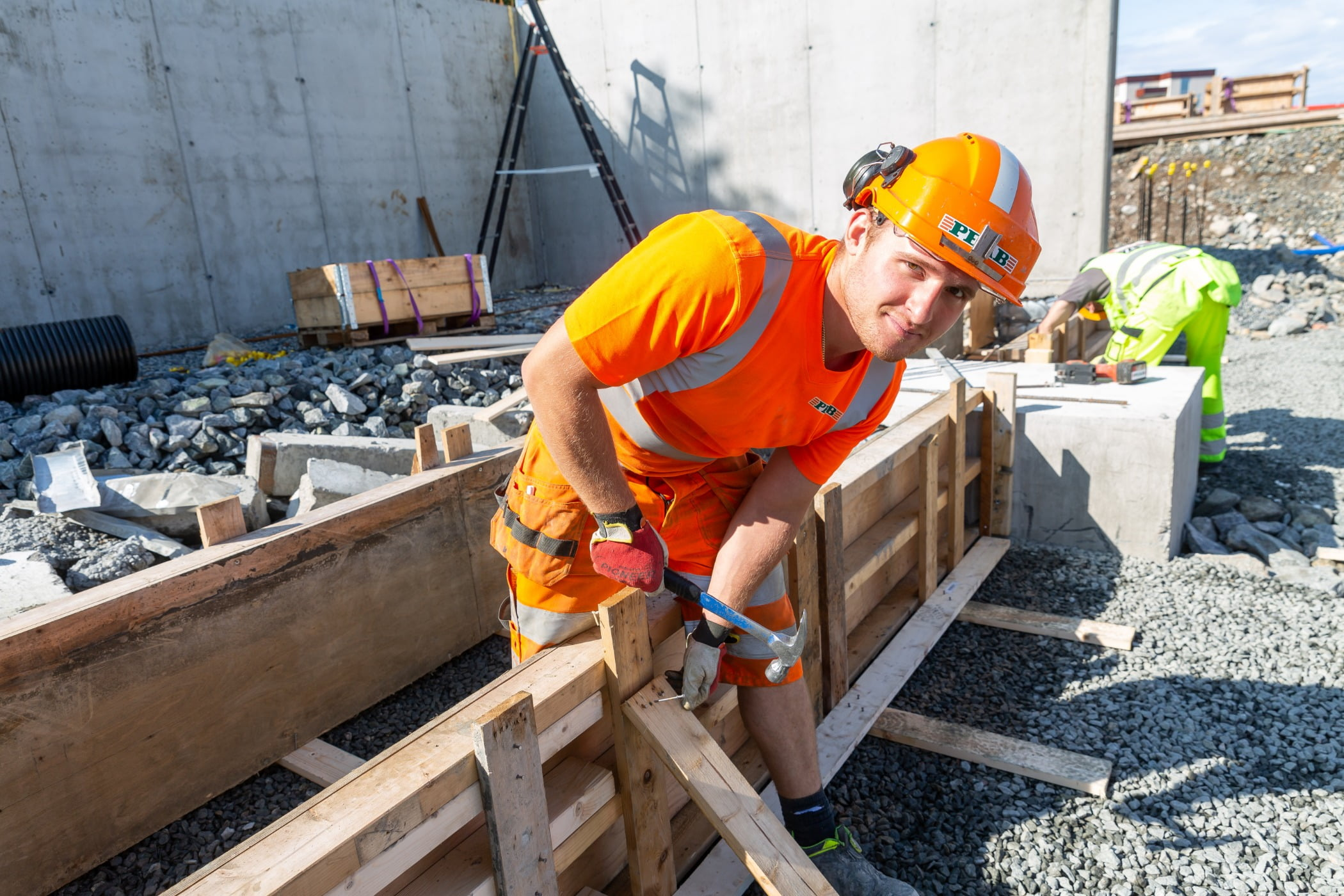 Hard hat, High-visibility clothing, Construction worker, Composite material, Tradesman, Workwear, Engineer, Helmet, Wood, Track
