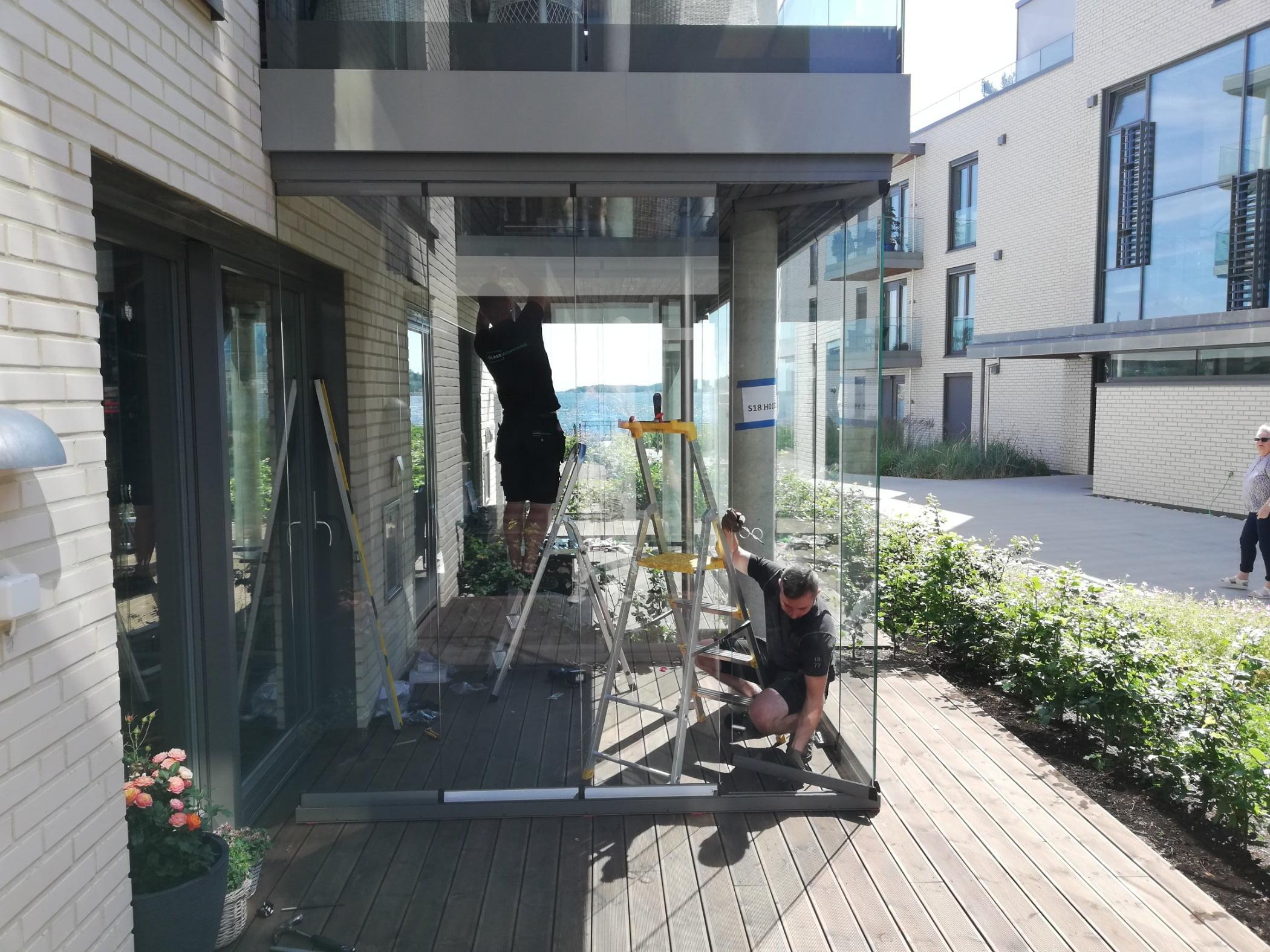 Road surface, Urban design, Plant, Window, Building, Flowerpot, Neighbourhood, Sidewalk, Houseplant