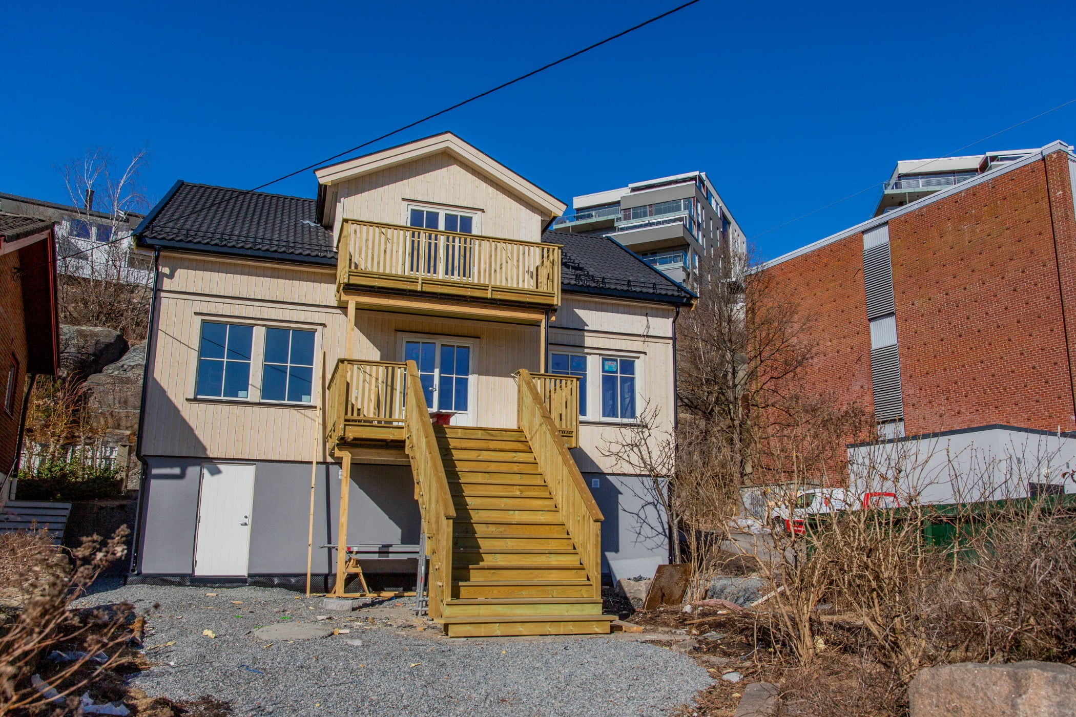 Land lot, Sky, Plant, Window, Building, Fixture, Door, House, Stairs, Wood