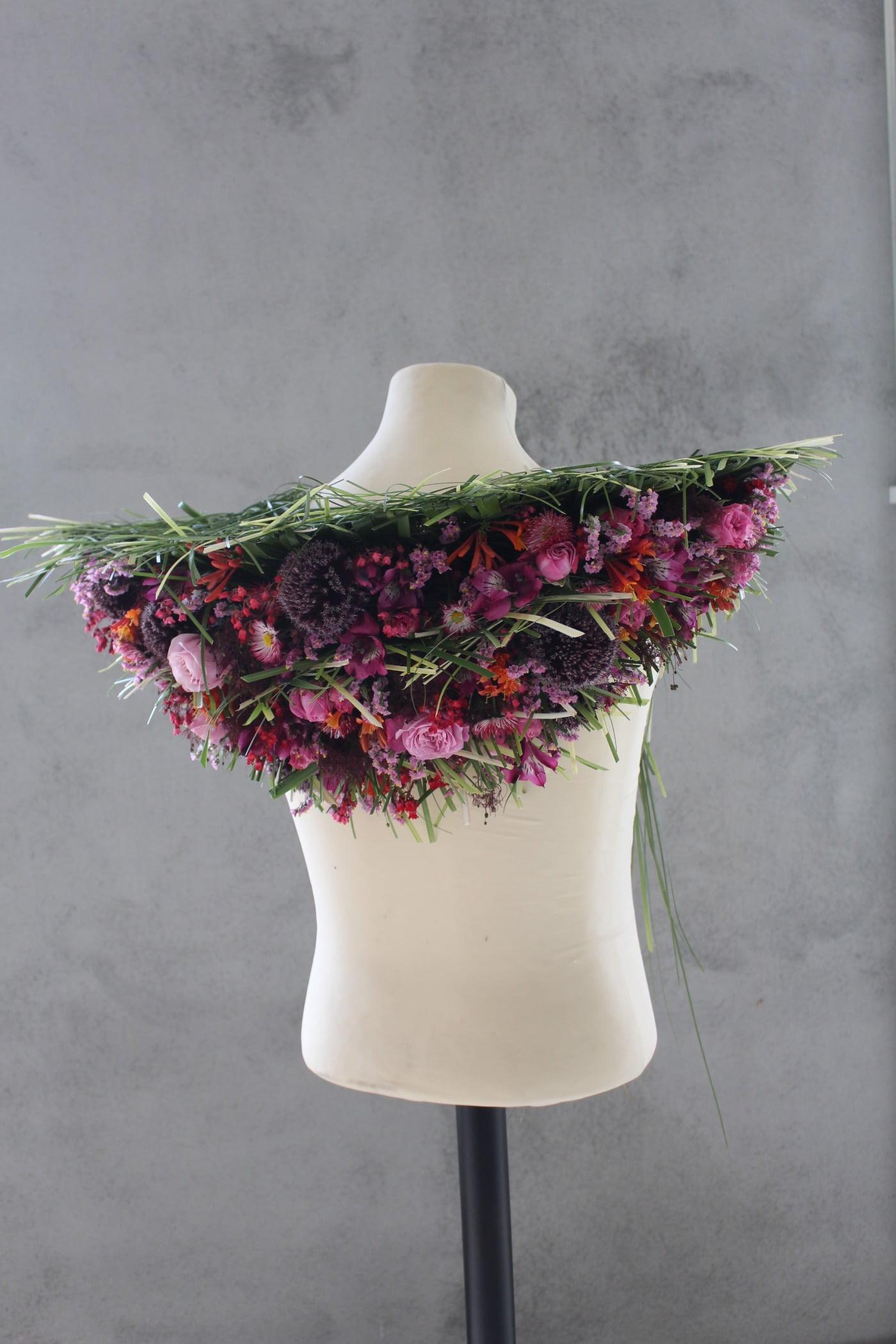 Creative arts, Floral design, Costume accessory, Lavender, Mannequin, Magenta, Petal