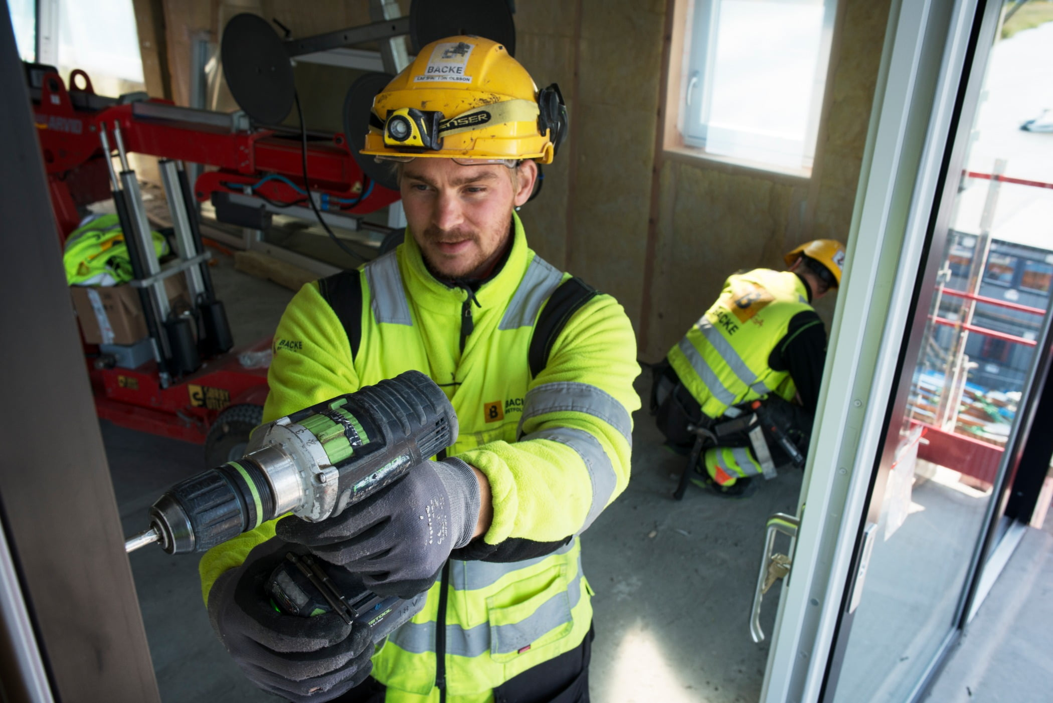 Hard hat, High-visibility clothing, Safety glove, Motor vehicle, Fire department, Helmet, Workwear, Tradesman, Yellow