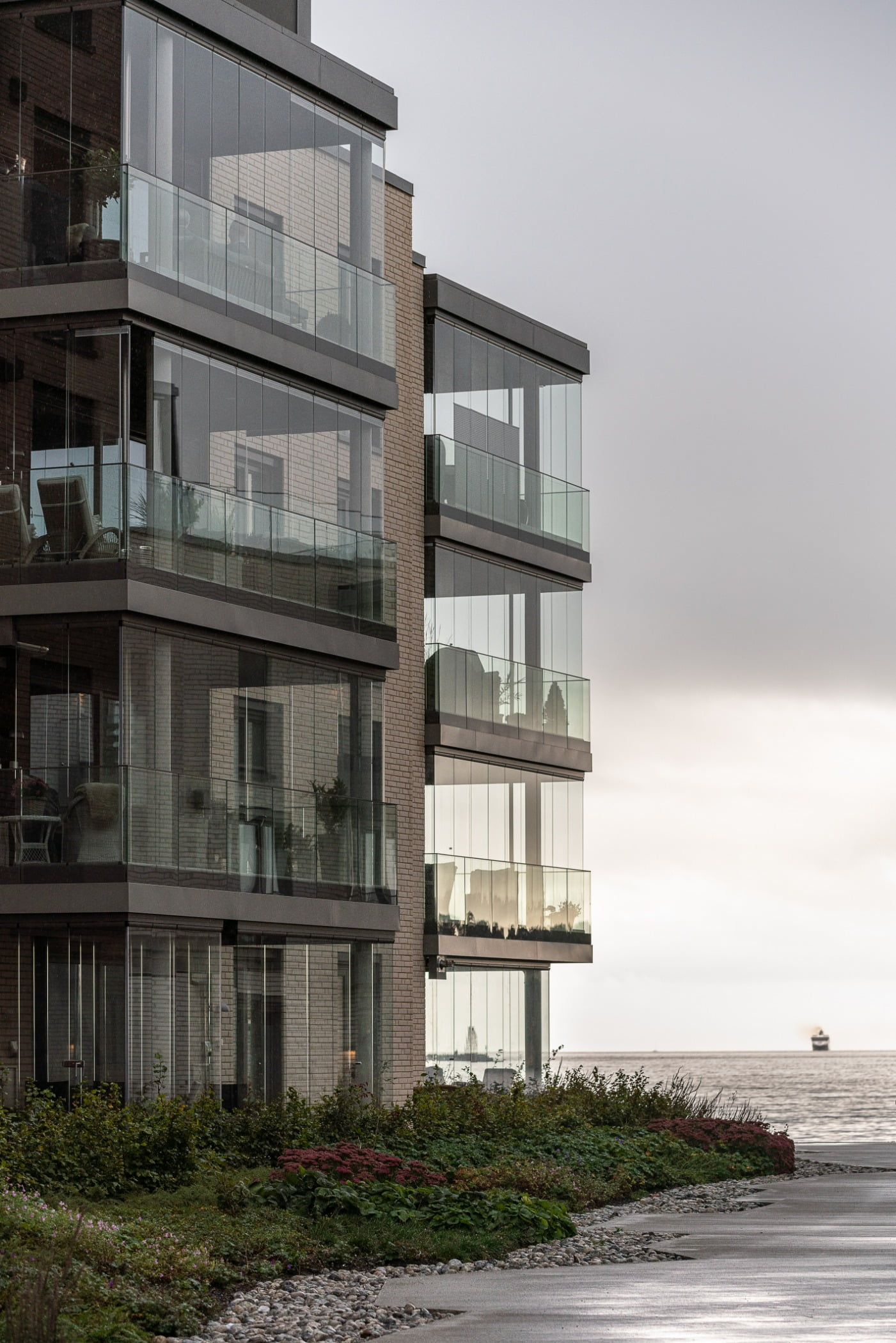 Urban design, Tower block, Plant, Water, Building, Sky, Cloud, Condominium, Window