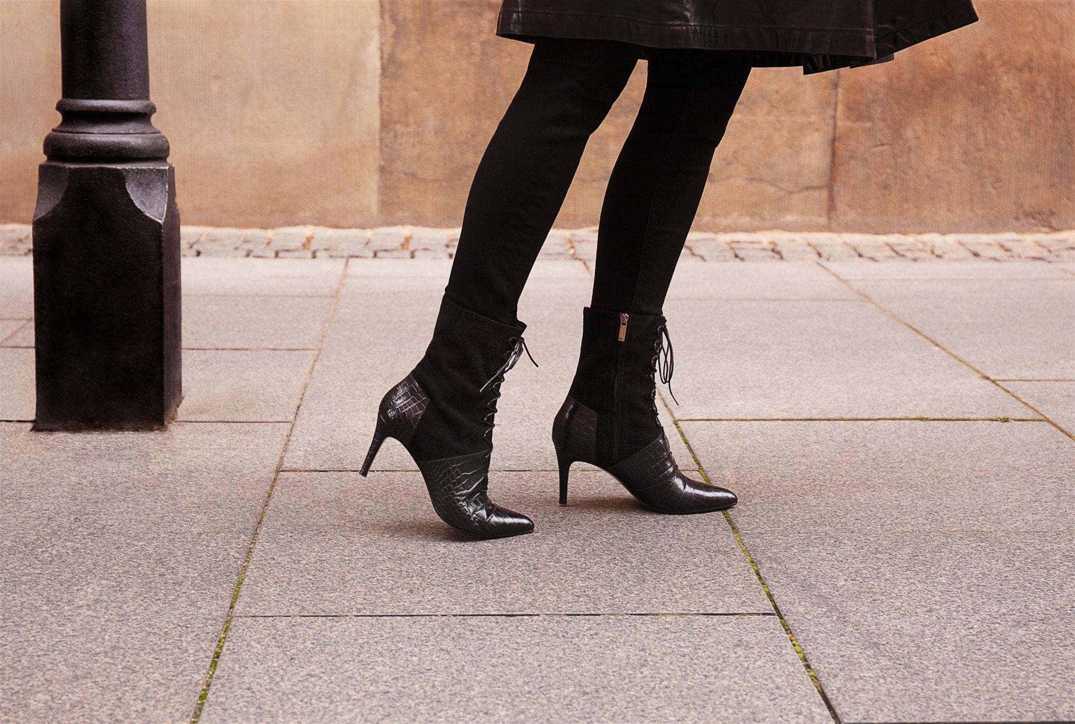 Human leg, High heels, Boot, Standing, Joint, Shoe, Ankle, Black, Footwear
