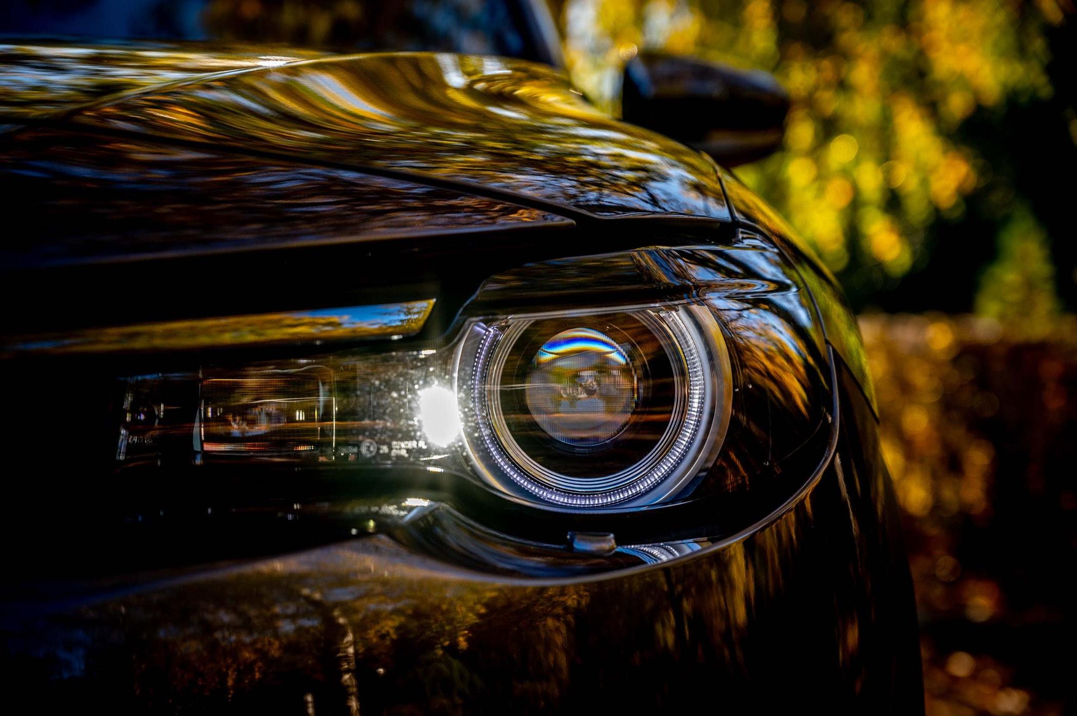 Personal luxury car, Auto part, Automotive design, Land vehicle, Light, Headlamp
